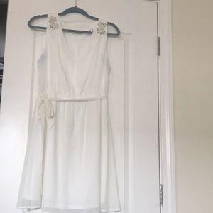 Dresses & Skirts - Cream sleeveless dress with design on shoulders